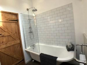 Bathroom with Rainfall Shower over Clawfoot Bath